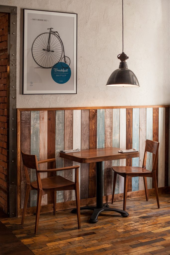 wooden dining set in a rustic cafe setting
